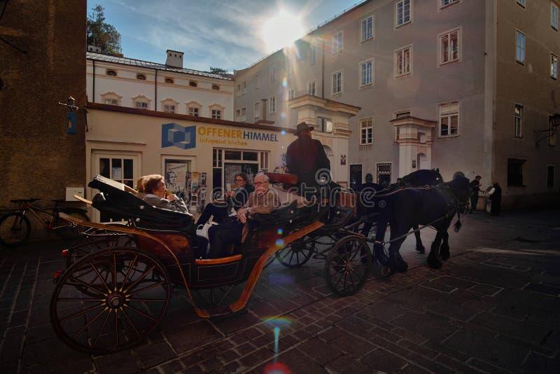 Salzburg, Salzburger Land, Austria -September 11, 2018: view of the historic city of Salzburg with traditonal horse-drawn carriage royalty free stock photos