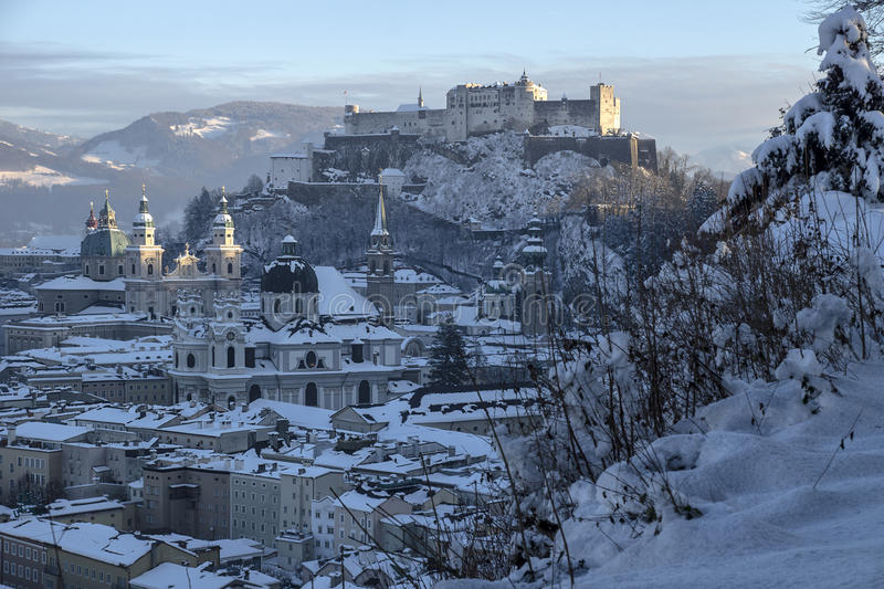 Salzburg wintertime. Old town of Salzburg covered with snow royalty free stock images