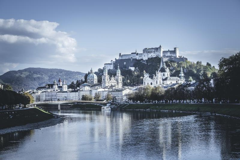 Old city of Salzburg an the river Salzach, magical old city, Europe. Salzburgs old city with fortress Hohensalzburg, blue sky europe magical trip holiday break stock images