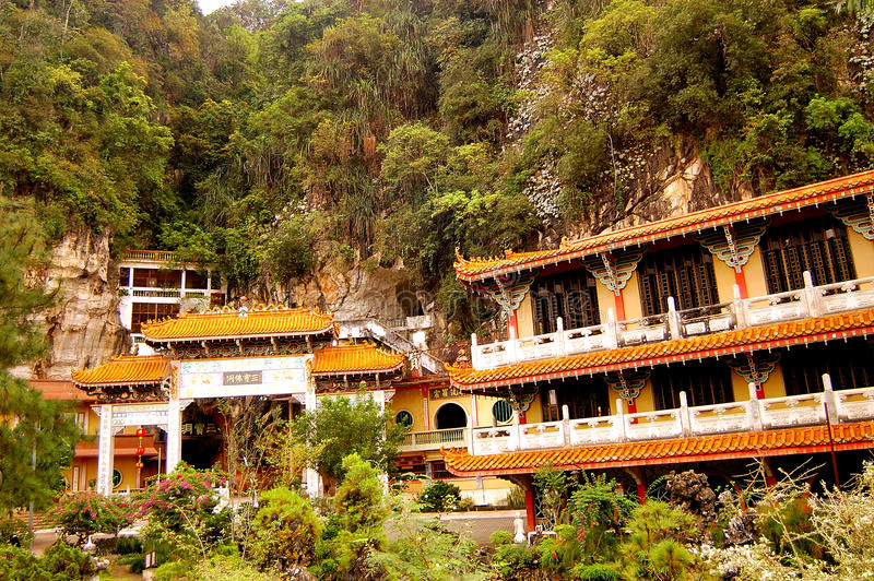 Sam Poh Tong Chinese Buddhist Temple. Sam Poh Tong, discovered in 1912, is a Chinese Buddhist Temple within a natural limestone hill. Located at Gunung Rapat in stock images
