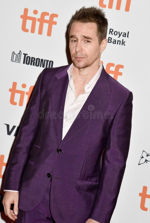 Sam Rockwell on red carpet for Jojo Rabbit movie premiere at TIFF. Sam Rockwell and his wife on red carpet for Jojo Rabbit movie premiere at TIFF . beautiful royalty free stock image