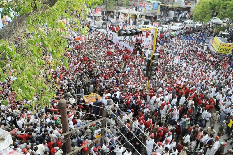 Samajwadi Party rally in India. VARANASI-MAY 10: Followers of Samajwadi Party flocking the streets during an election rally of UP Chief Minister Akhilesh Yadav stock photography