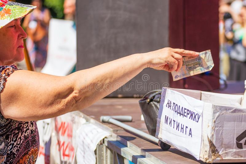Samara, August 2018: a hand giving money to charity stock image