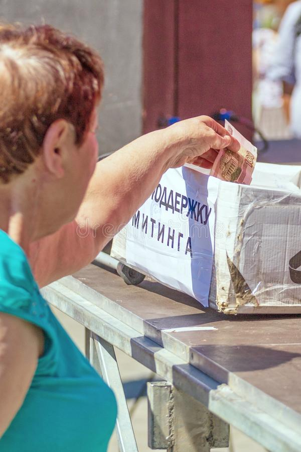 Samara, August 2018: a hand giving money to charity stock images