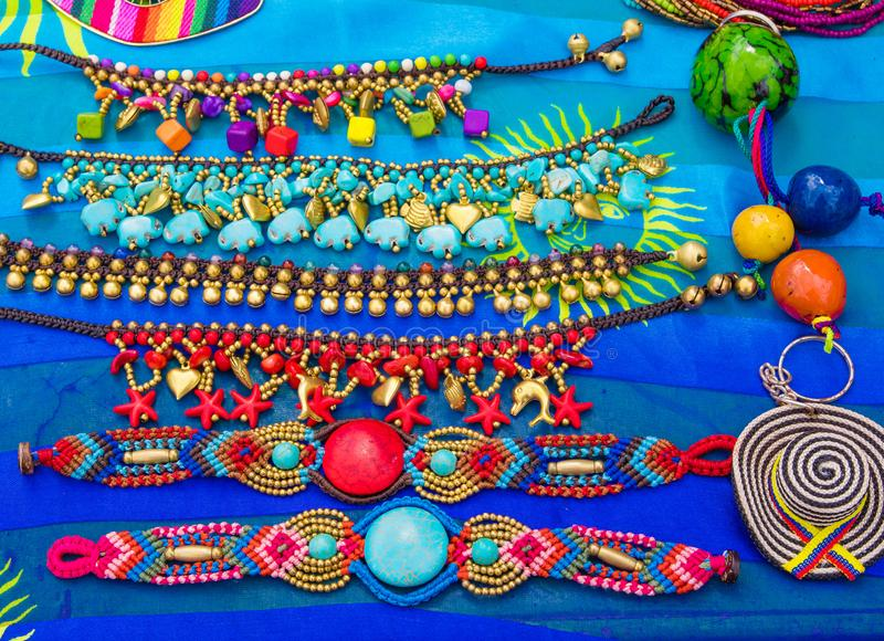 Samara, Costa Rica, June, 26, 2018: Close up of beautiful and colorful handycrafts in a street store over a blue fabric stock photography