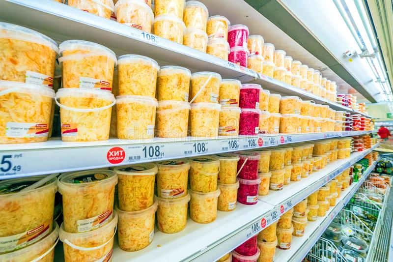 Samara March 2019: sauerkraut in plastic cans on store shelves royalty free stock photo