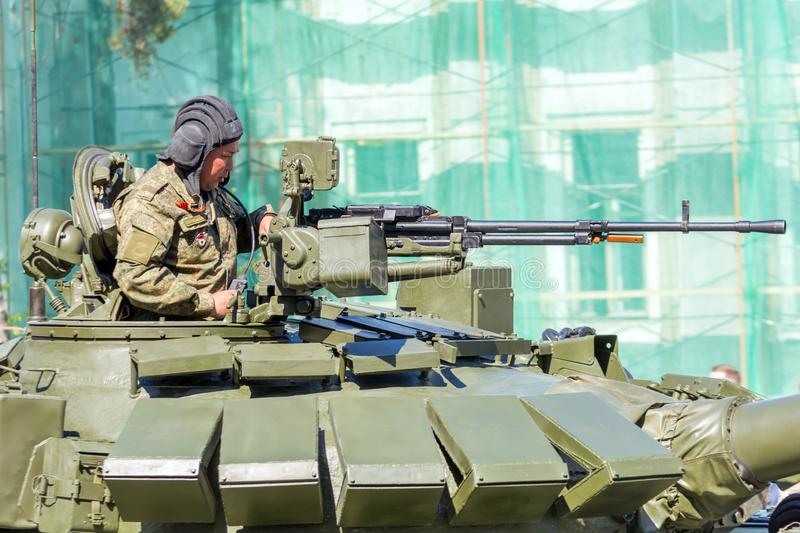 Samara, May, 2018: an armed soldier on the T-72B3 Grand Tank with a heavy machine gun royalty free stock photo