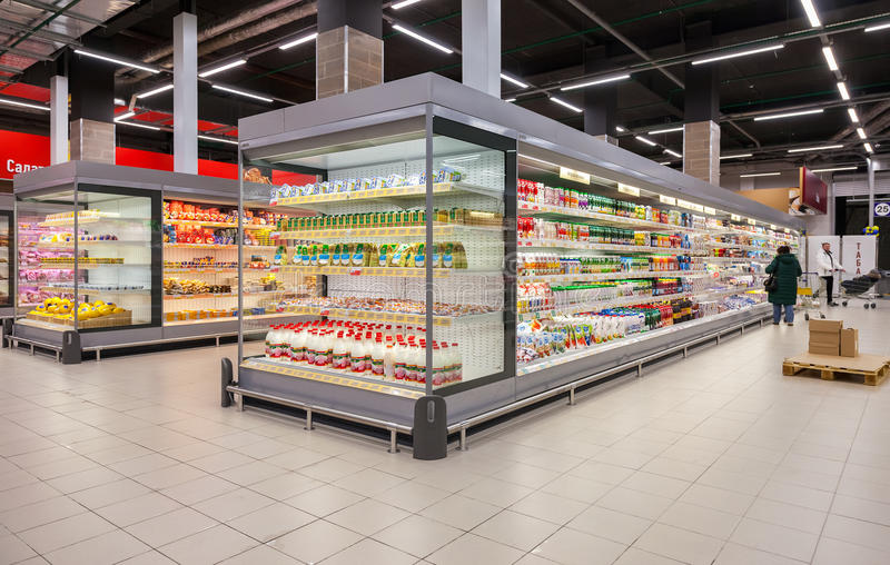 Fresh dairy products ready for sale in supermarket Lenta stock images
