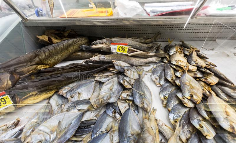 Showcase with tasty different dried fish in hypermarket. Samara, Russia - January 6, 2018: Showcase with tasty different dried fish in hypermarket stock photos