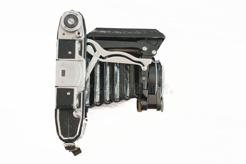 Samara Russia - 04.27.19 lens accordion on an old camera. Old vintage camera on a wooden light background. small format old camera royalty free stock photo