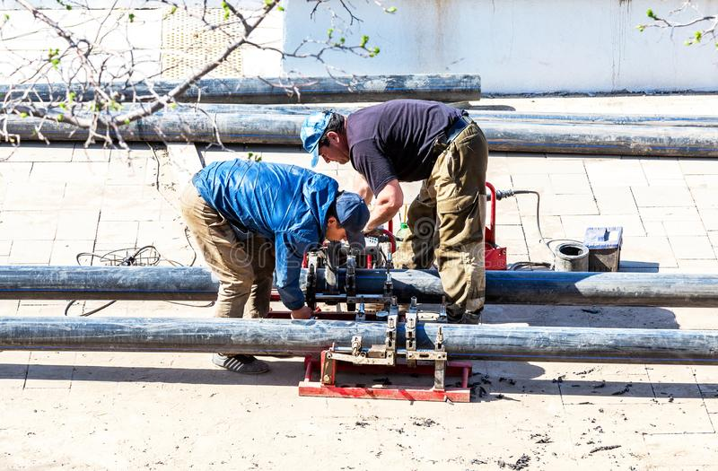 Workers produce work of laying plastic water pipes stock images