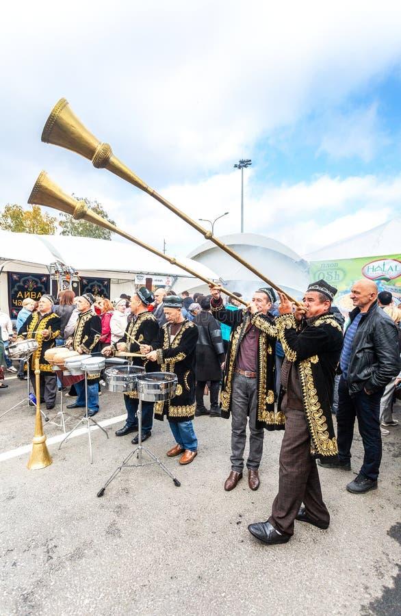 Uzbek ethnic musicians playing on musical folk instruments stock photography