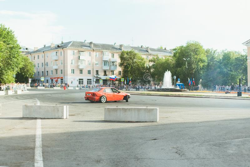 Samara Russia - 07.05.19 Youth Day in Russia. People in the square look like a car drift on the roads. Smoke from under the tires royalty free stock photography