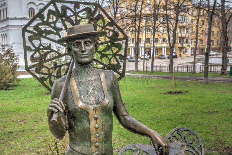 Samara rzeźbiona skład dama z kantem w jesieni Samara obraz royalty free