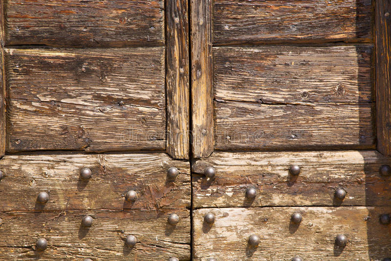 Samarate abstract closed wood lombardy italy varese. Samarate abstract rusty brass brown knocker in a door curch closed wood lombardy italy varese royalty free stock photography