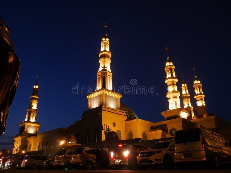 Samarinda, Kalimantan Timur, Indonesia, June 6th 2019, Islamic Center Mosque. Shows it& x27;s light under under deep blue sky, low angle view, kaltim, religion royalty free stock image