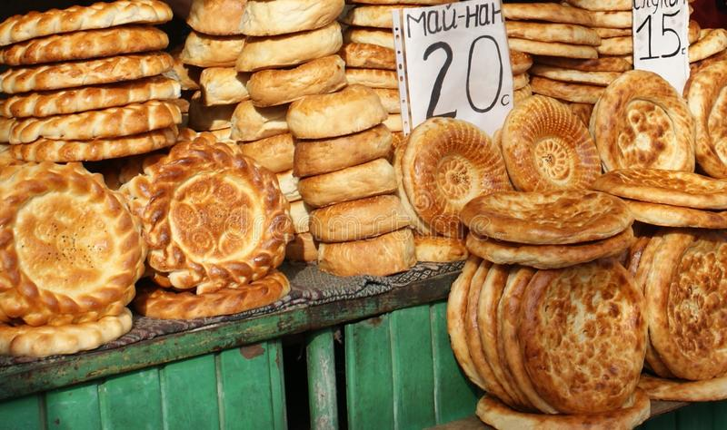 Samarkand bread in a market in Uzbekistan. Decorative round Samarkand bread in a market in Uzbekistan stock images