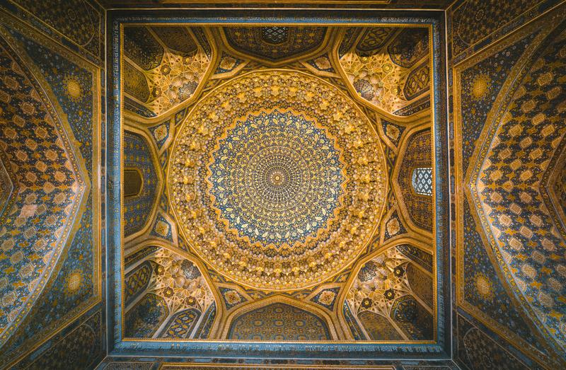 Detail of gold mosaic dome in Tilya Kori Madrasah in Samarkand, Uzbekistan stock photos