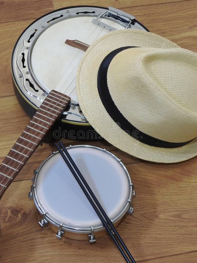 A samba player sambista hat and two Brazilian musical instruments: a samba banjo and a tamborim with drumstick. stock photos