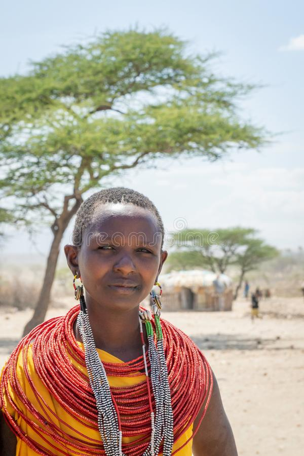 Samburu, Kenya/Africa - 10.05.2014: Outdoor portrait of a young native woman with colorful necklace and handmade jewelry royalty free stock photo