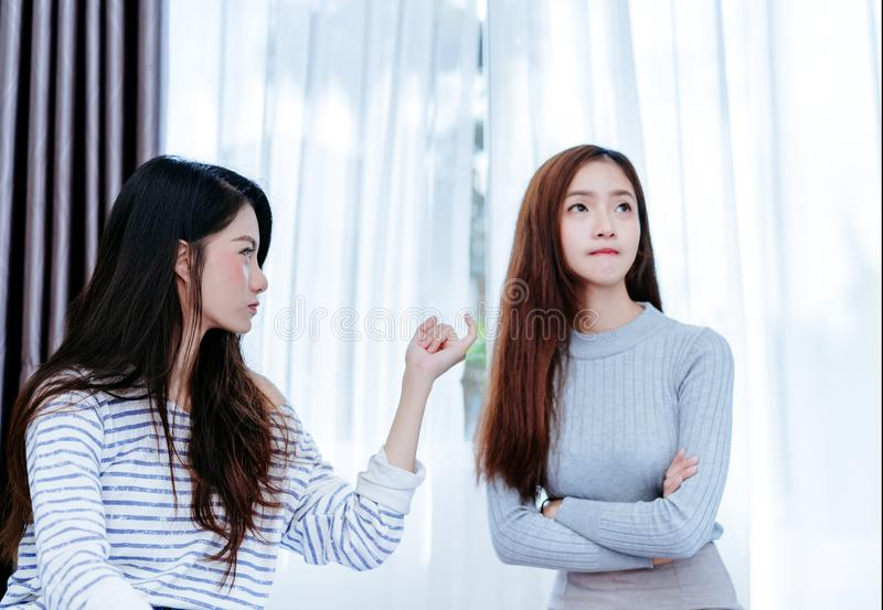 Same sex asian lesbian couple lover reconcile girlfriend. Argument in the bedroom at morning angry feeling, LGBT sexuality female living together at home royalty free stock images