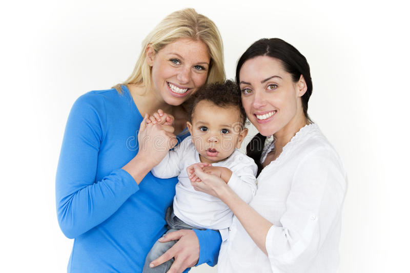 Same sex couple with baby son stock images