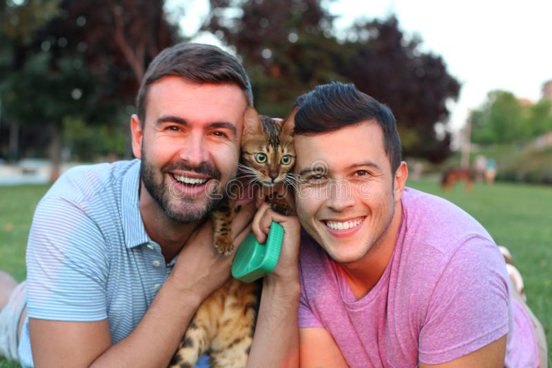 Same sex couple with a gorgeous pet outdoors.  royalty free stock photos