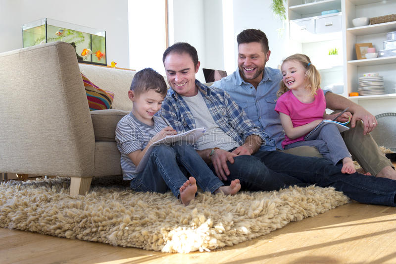 Same sex couple at home with children stock image