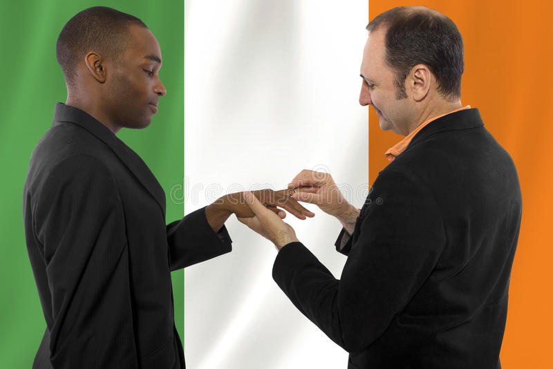Same Sex Couple in Ireland. Interracial male gay couple celebrating legalization of same-sex marriage in Ireland stock photo