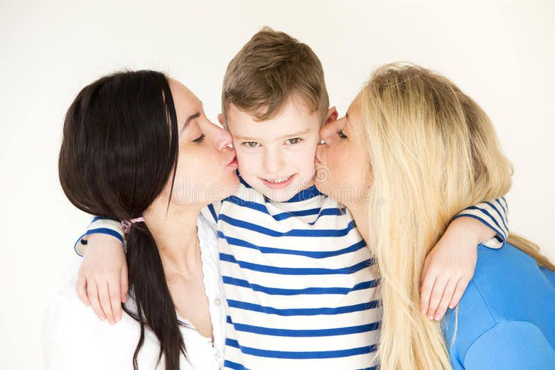 Same sex couple kissing their son royalty free stock photos