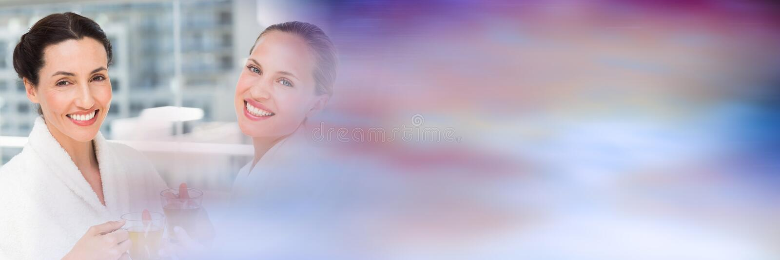Same sex couple on spa day with blurry purple transition. Digital composite of Same sex couple on spa day with blurry purple transition royalty free stock photo
