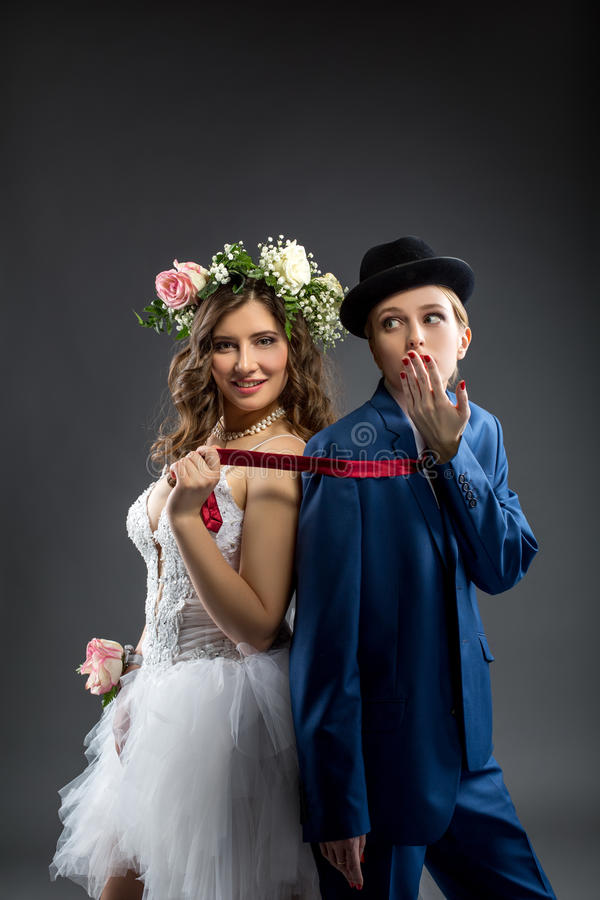 Same-sex marriage. Shot of elegant bride and groom. Concept of same-sex marriage. Elegant bride and groom royalty free stock photo