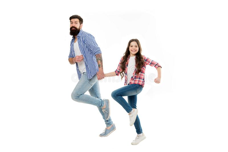On same wave concept. Bearded father and small child walking going or running together. Move on. Lets move. Kid and dad. Cheerful friends in motion. Move in stock photography