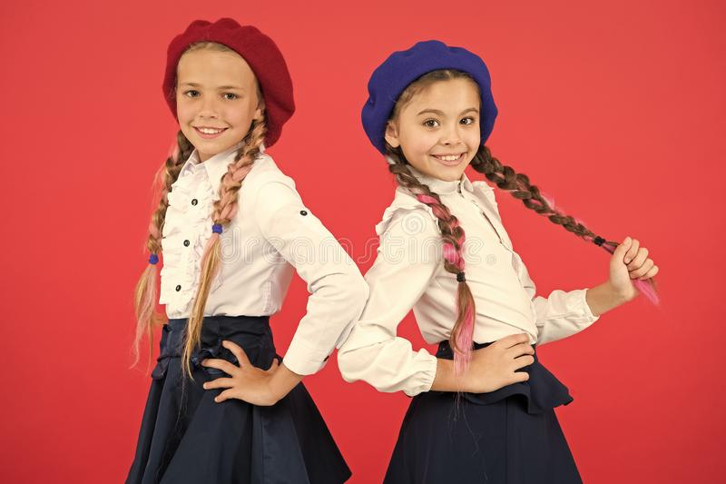 On same wave. Schoolgirls wear formal school uniform. Children beautiful girls long braided hair. Little girls with. Braids ready for school. School fashion royalty free stock images