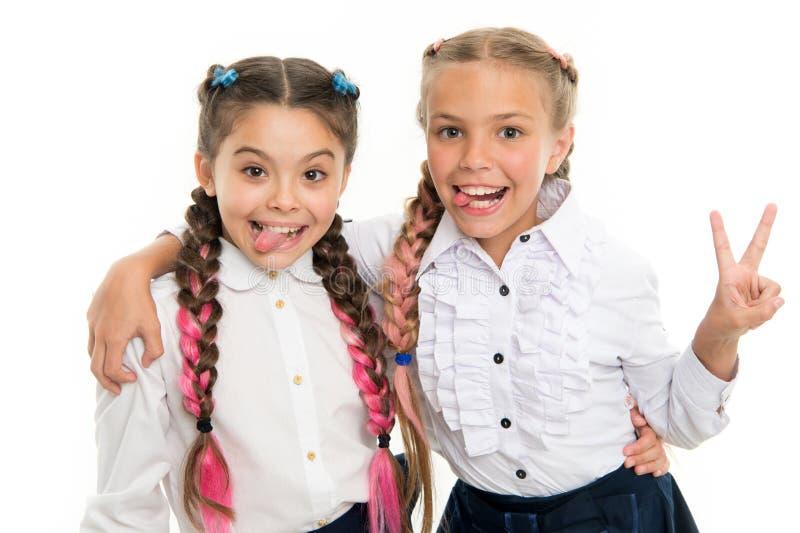 On same wave. Schoolgirls wear formal school uniform. Sisters little girls with braids ready for school. School fashion. Concept. Be bright. School friendship royalty free stock images