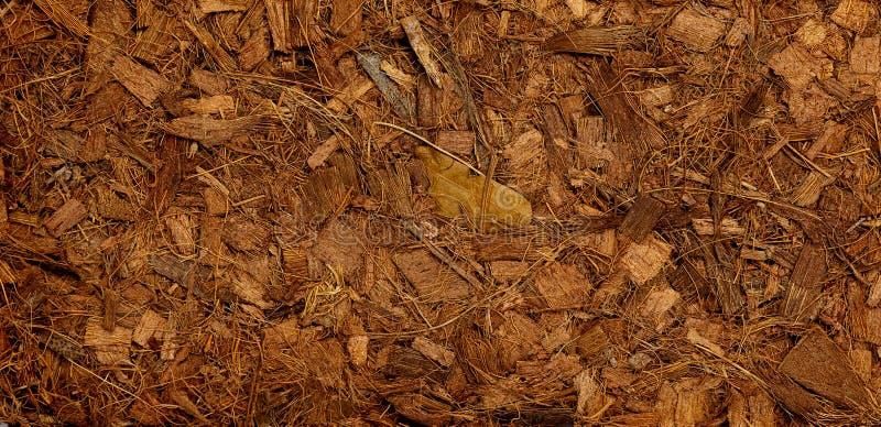 Samengeperste baal van shell van de grondkokosnoot vezelscoir, oppervlakteachtergrond stock foto