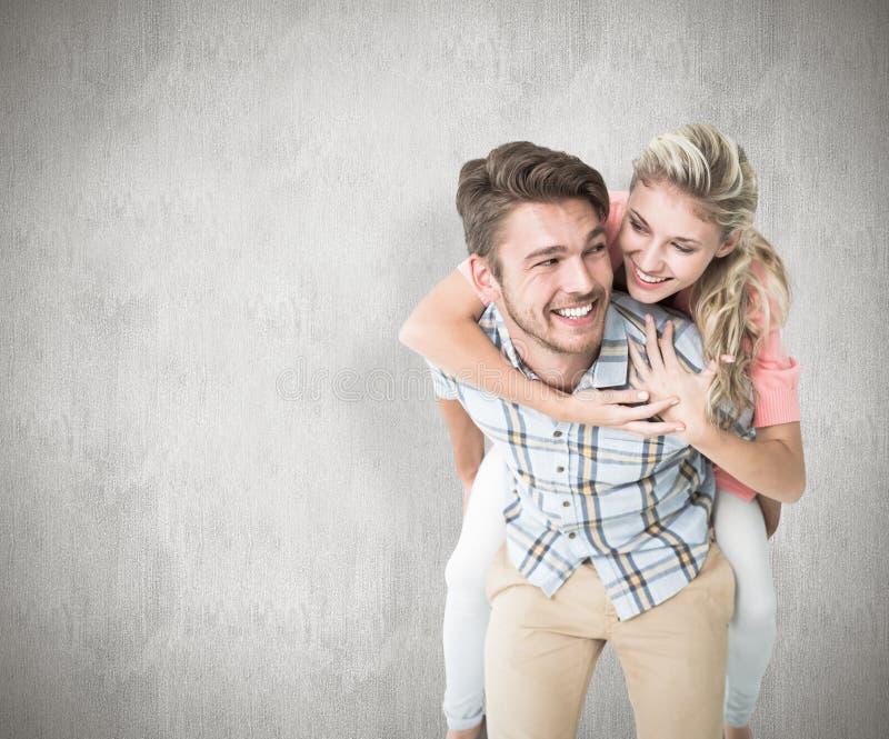 Samengesteld beeld die van de knappe mens op de rug aan zijn meisje geven royalty-vrije stock foto's