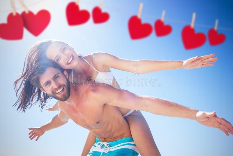 Samengesteld beeld die van de knappe mens op de rug aan zijn meisje geven royalty-vrije stock afbeeldingen