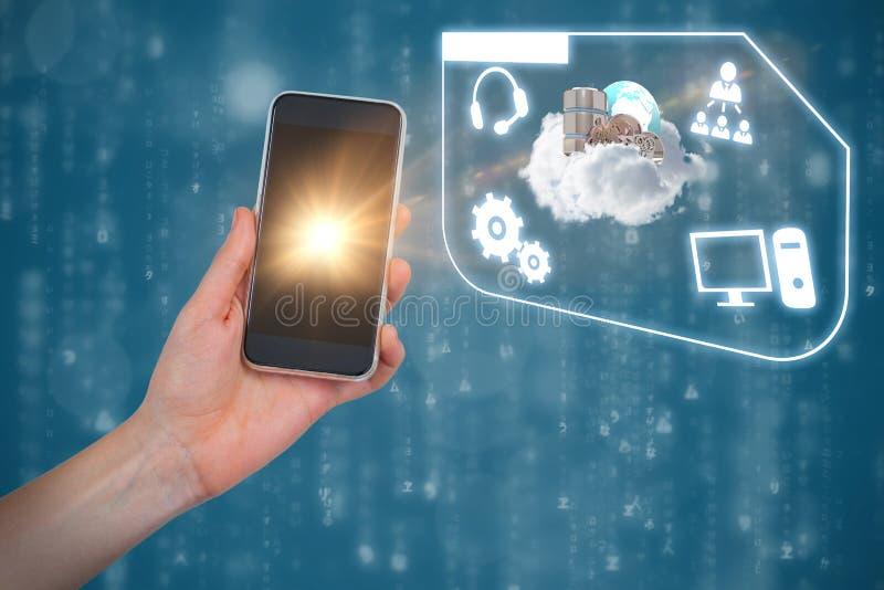 Samengesteld beeld die van hand mobiele telefoon houden tegen blauwe achtergrond royalty-vrije stock fotografie
