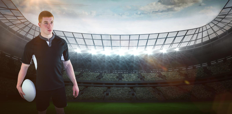 Samengesteld beeld die van rugbyspeler een rugbybal 3D houden stock afbeeldingen