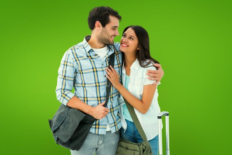 Samengesteld beeld van aantrekkelijk jong paar die op hun vakantie gaan stock fotografie