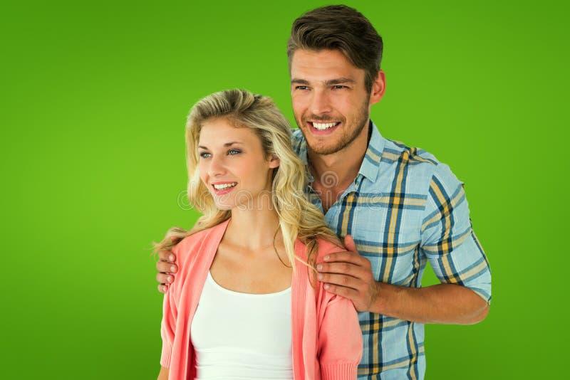 Samengesteld beeld van aantrekkelijk jong paar die samen glimlachen royalty-vrije stock foto