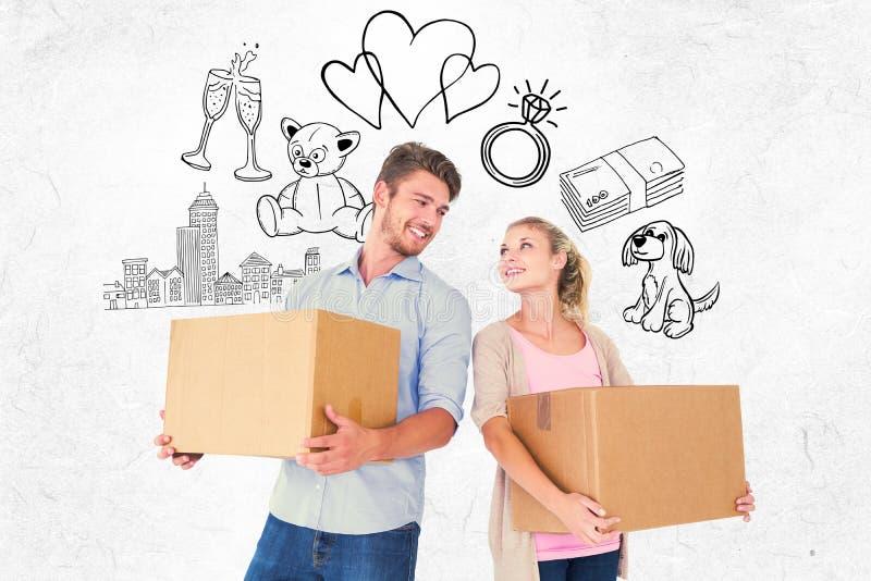 Samengesteld beeld van aantrekkelijke jonge paar dragende bewegende dozen stock foto