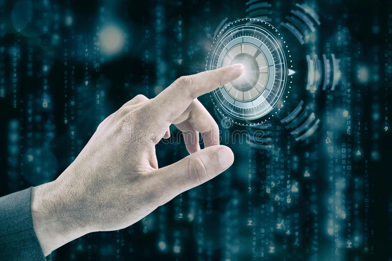 Samengesteld beeld van bebouwde hand van zakenman wat betreft het digitale scherm stock afbeelding