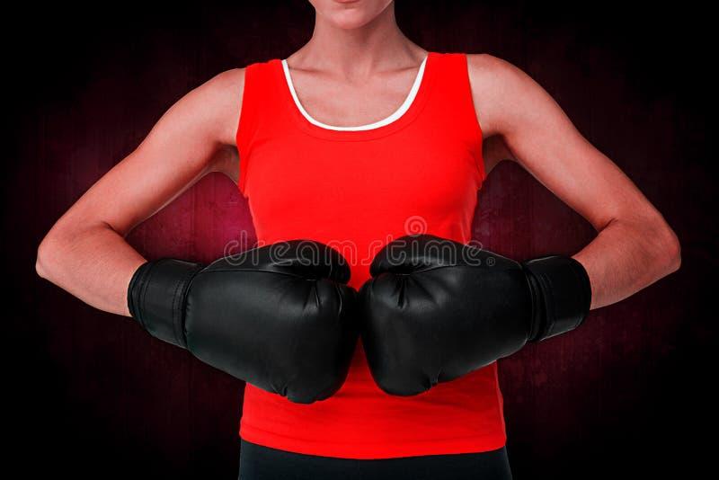 Samengesteld beeld van close-up medio sectie van een bepaalde vrouwelijke bokser stock afbeelding