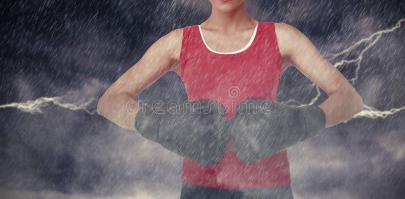 Samengesteld beeld van close-up medio sectie van een bepaalde vrouwelijke bokser stock foto