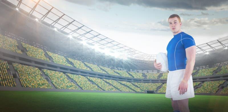Samengesteld beeld van 3D de bal van het de holdingsrugby van de rugbyspeler royalty-vrije stock afbeeldingen