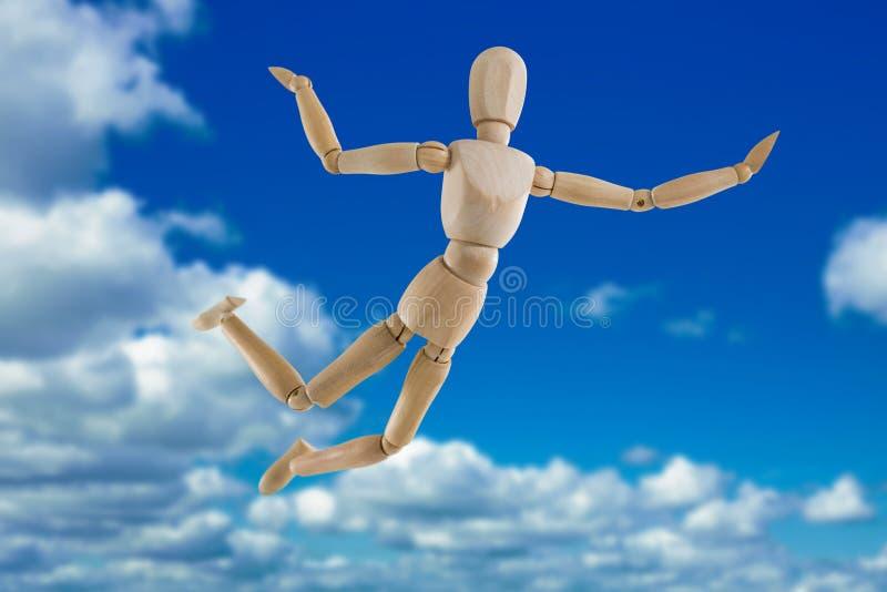 Samengesteld beeld van 3d illustratie van onbezorgd houten beeldje die in lucht springen royalty-vrije illustratie