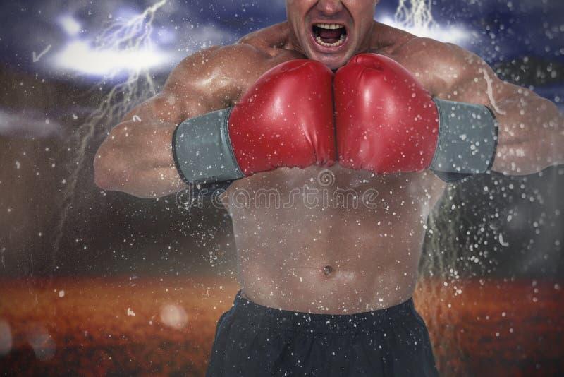 Samengesteld beeld van de agressieve spieren van de bokserverbuiging royalty-vrije stock fotografie