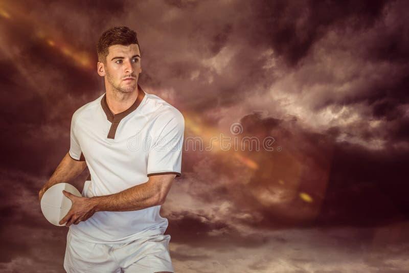 Samengesteld beeld van de holdingsbal van de rugbyspeler royalty-vrije stock afbeeldingen